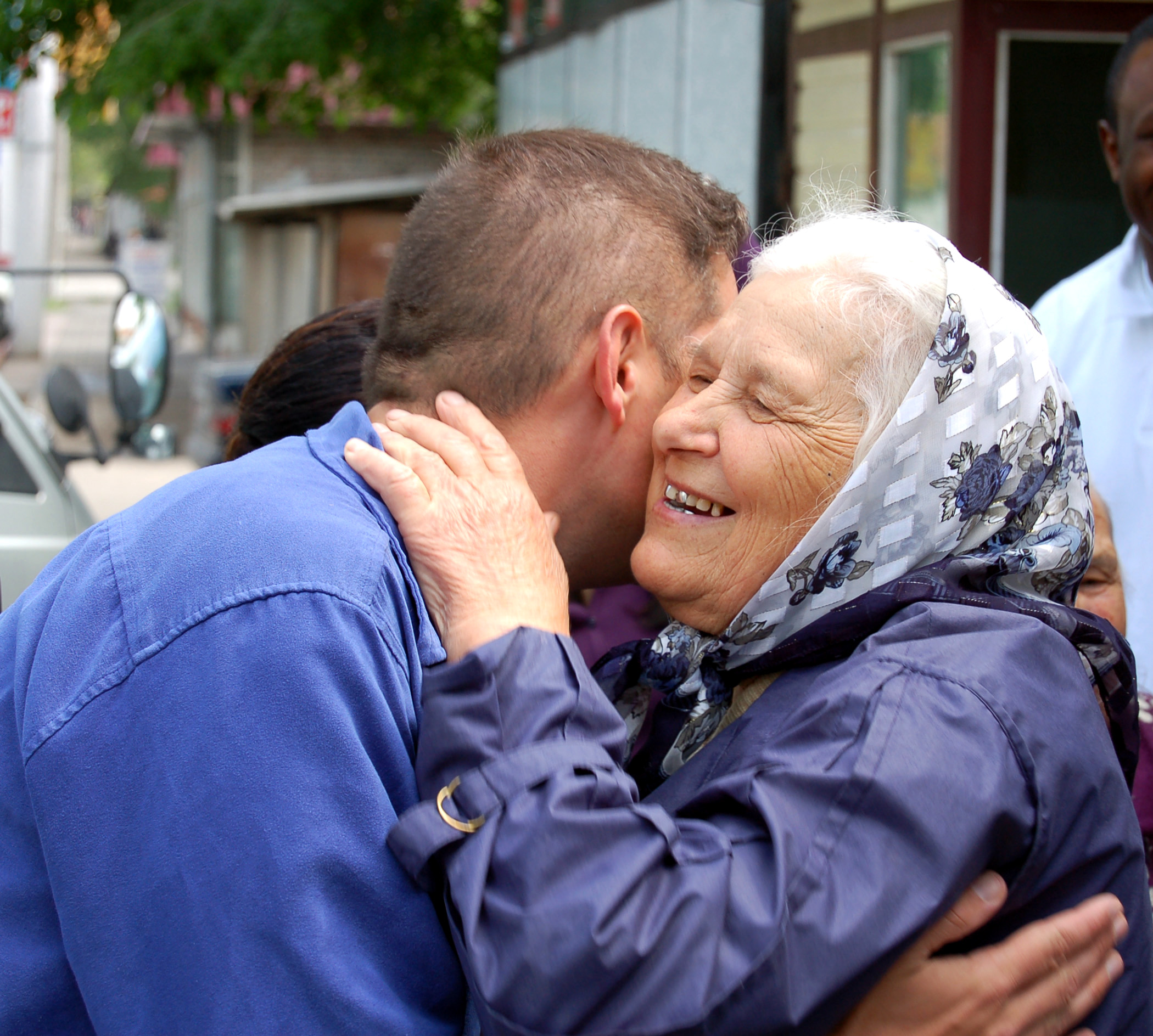 Thumbnail image for man hugging elderly.jpg
